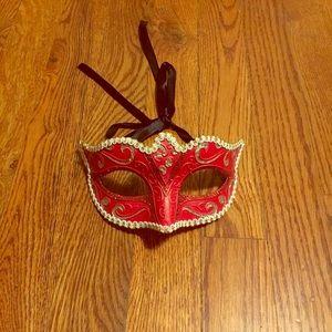 Masquerade mask, costume mask.
